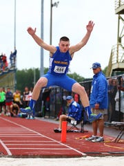 Maine-Endwell senior Michael Palmer long jumps on his way to a repeat state pentathlon championship.