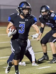 U-Prep running back Nate Sowles runs the ball during a game in 2016.