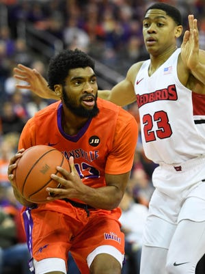 University of Evansville's K.J. Riley (33) looks to pass under pressure from Illinois State's William Tinsely (23) as the University of Evansville plays Illinois State on West Side Day at the Evansville Ford Center Saturday, December 23, 2017.
