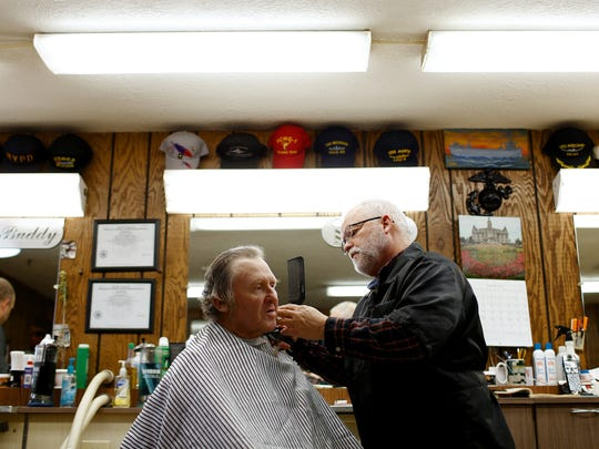 Dave Wickert, known as 'Dr. Dave'  Wickert cuts  Roger Strom's hair at Russ's Barber Shop in Green Bay.