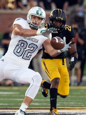 Eastern Michigan's Nigel Kilby, left, catches a pass in front of Missouri's Anthony Sherrils on Sept. 10, 2016.