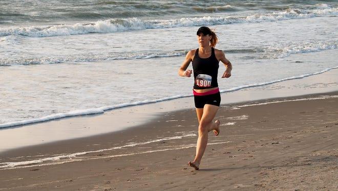 Kristen Klein cruises down the beach during the U.S.A. Beach Running Championships in 2016.