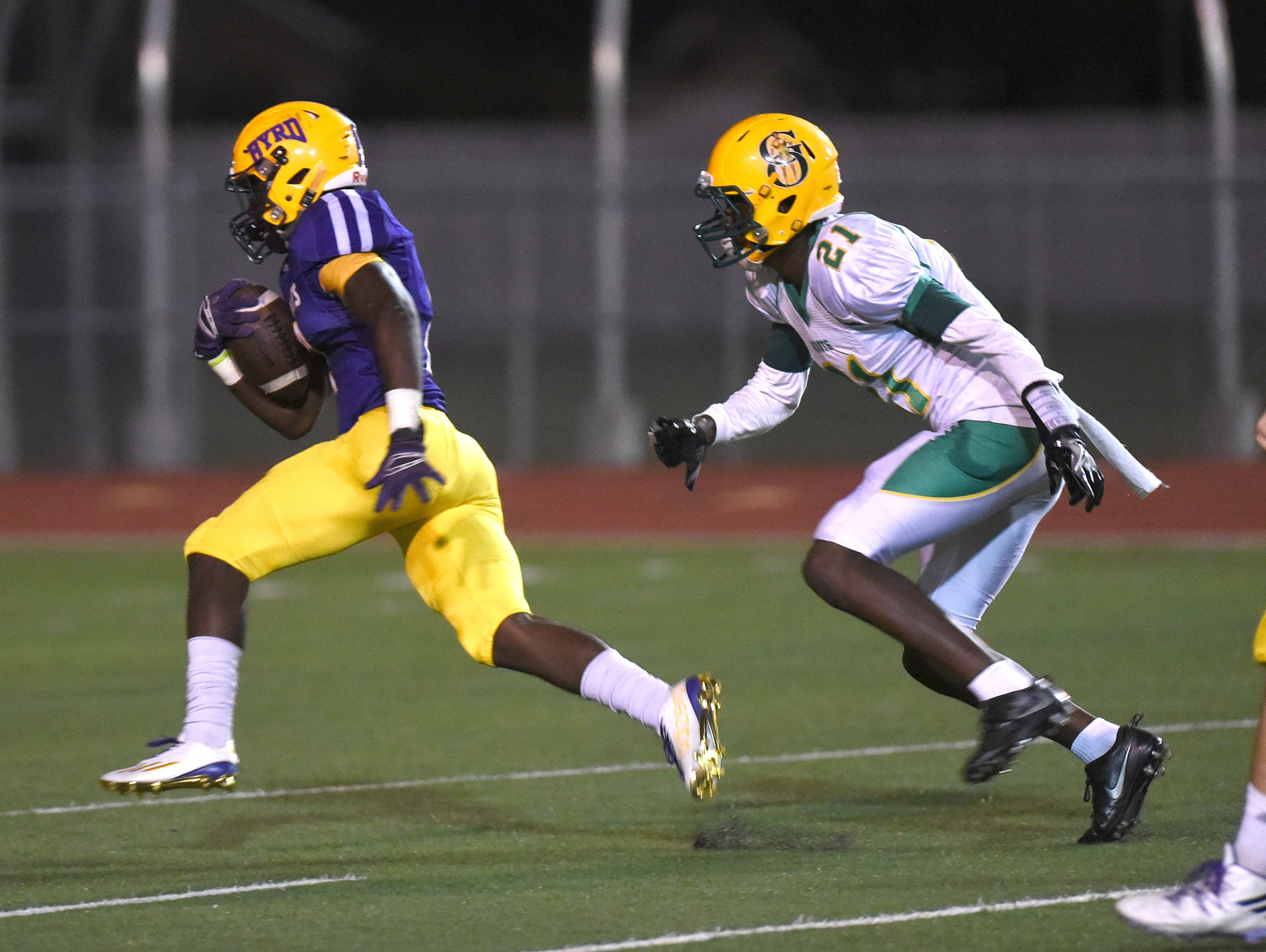 C.E. Byrd's Javien Wilson shakes Damien Crawford of Green Oaks to run in for a touchdown.