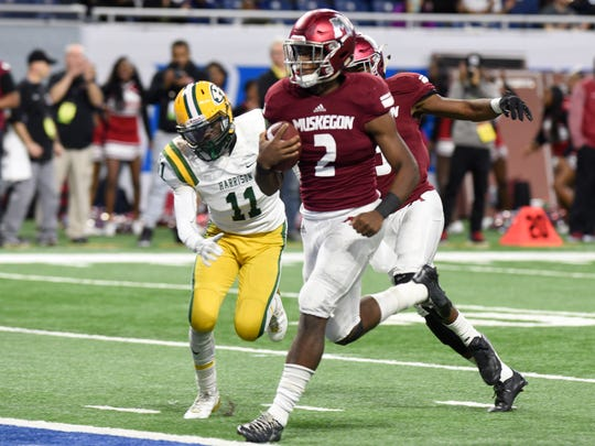 Muskegon QB La'Darius Jefferson scores one of his four TDs in the second quarter of the Division 3 state championship game at Ford Field Saturday, Nov. 25.
