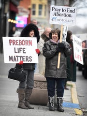 Pat Young, of Palmyra, and Kay Marshall, of Cleona, stand at the intersection of Eighth and Cumberland streets in Lebanon Friday, Jan. 22, 2016, to show their support for the pro-life movement. The annual rally is held on Jan. 22, because on that date in 1973, the U.S. Supreme Court made its decision in Roe v. Wade that effectively granted a women the right to abortion.