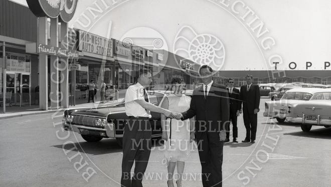 The black and white photographshows the exterior of the Red Owl and other shops at the Green Bay Plaza Shopping Center on Military Avenue at West Mason Street in 1964.