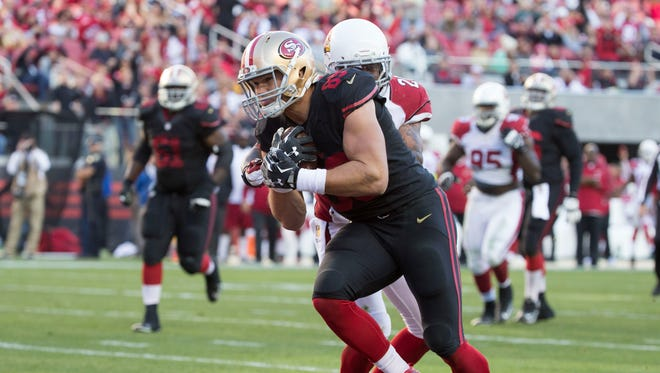 San Francisco 49ers tight end Vance McDonald (89) runs in for a touchdown against Arizona Cardinals free safety Rashad Johnson (26) during the third quarter at Levi's Stadium.