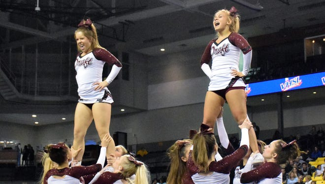 Stuarts Draft's competition cheer team performs during the first round of the Group 2A championships at the Siegel Center in Richmond on Saturday, Nov. 5, 2016.