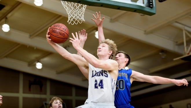Redding Christian's Austin Larson goes up for a basket in a 2017-18 game against Fall River.
