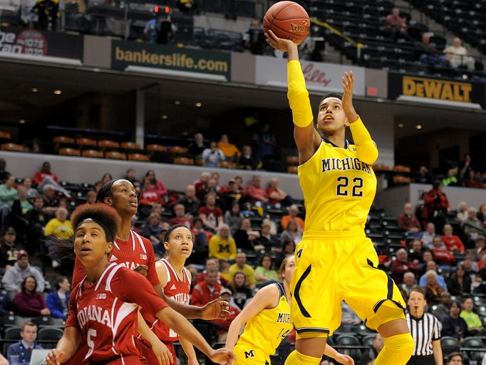 Michigan forward Cyesha Goree shoots a layup against Indiana during the first round of the Big Ten Women's Basketball Tournament at Bankers Life Fieldhouse, Thursday, March 6, 2014, in Indianapolis.