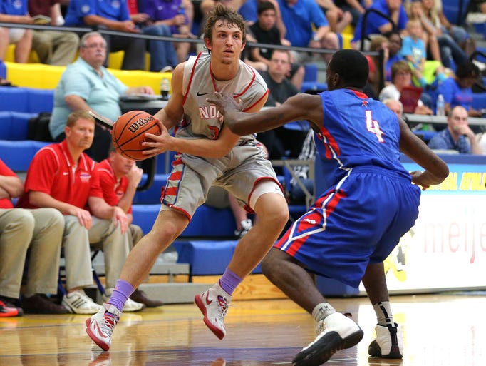 Indiana's Matt Holba looks to drive around Kentucky's Jaqualis Matlock during the Junior All-Star Game, Friday, June 6, 2014, at Greenfield Central High School. Indiana won the game 127-104.