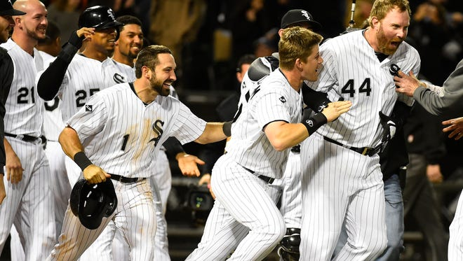 White Sox designated hitter Adam Dunn (44) celebrates with teammates after hitting a two-run walk-off  home run in the ninth inning at U.S Cellular Field Friday night.
