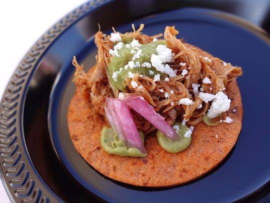Guajillo chile braised rabbit taco with queso fresco,