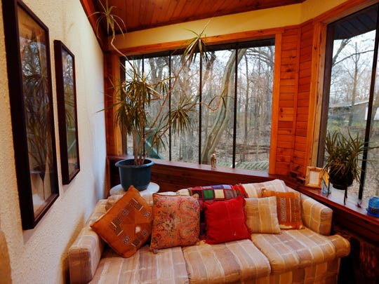 The short-term rental property called Beaverdale Lodge features various sitting areas and views of the backyard ravine Tuesday, Dec. 1, 2015 in Des Moines.