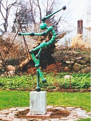 """""""Jester,"""" a copper statue reported stolen recently from the yard of a home in Brighton."""