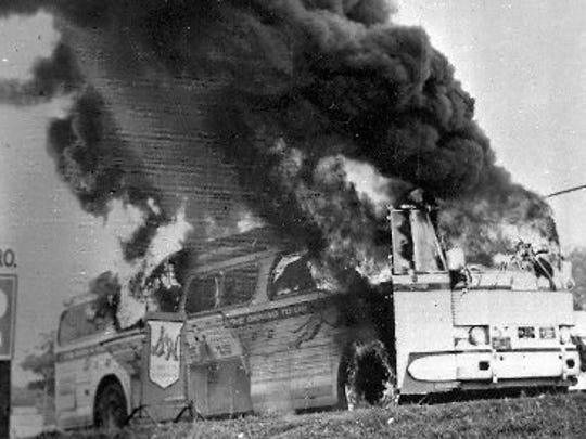 This is a May 1961 file photograph of a Freedom Rider bus that went up in flames when a fire bomb was tossed through a window near Anniston, Ala.