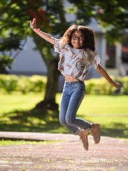 Maria Hope Diaz, 11, takes to the air during a visit