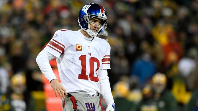 New York Giants quarterback Eli Manning (10) during the fourth quarter. The Green Bay Packers defeated the New York Giants 38-13 in the NFC Wild Card playoff game at Lambeau Field in Green Bay, WI on Sunday, January 8, 2017.