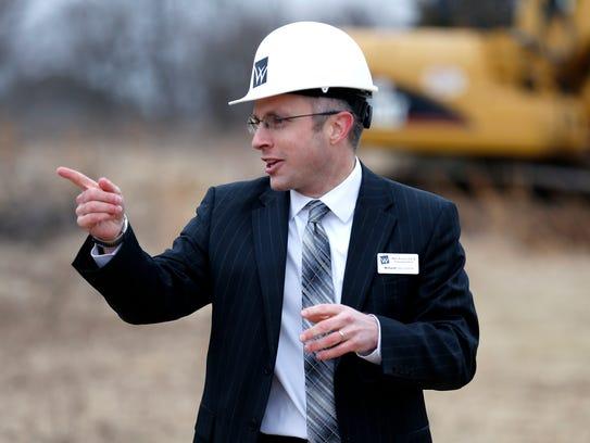 Willard Superintendent Matt Teeter speaks after a groundbreaking