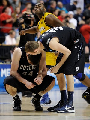 FILE – Butler Bulldogs forward Emerson Kampen (30) consoles center Andrew Smith (44) after losing to Marquette in the NCAA tournament.
