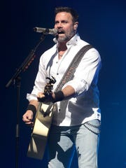 Troy Gentry of the Country Music duo Montgomery Gentry performs in 2013, in Lancaster, Pa.