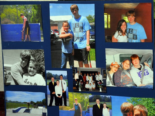 A collection of family pictures of Deven Guilford on a display prepared by his family.