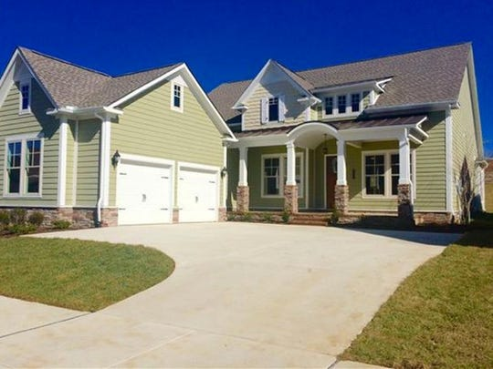 This three-bedroom Thompson's Station home is on a private site and has a covered patio.