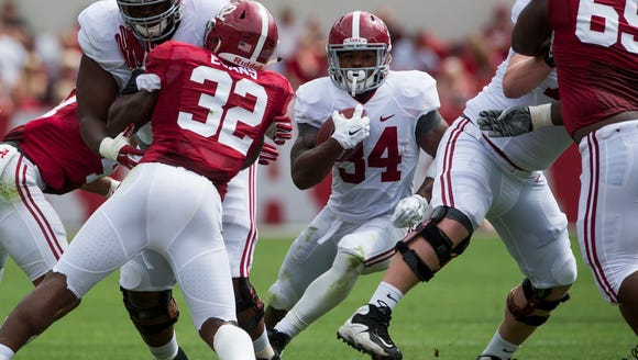 Alabama running back Damien Harris (34) rushed for