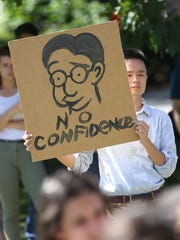 Harry Gu, a University of Rochester student, holds
