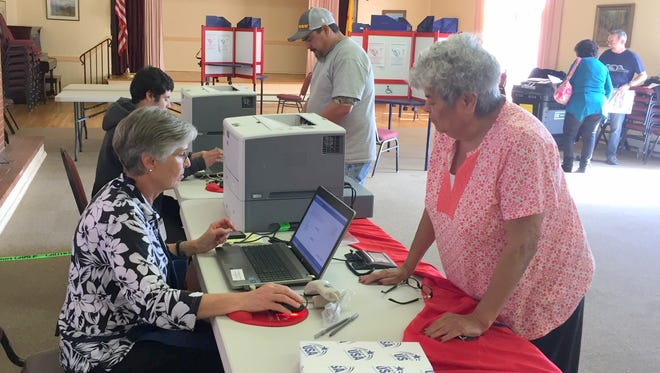 Dora Sierra, right front, and Larry Trujillo, right back, get ready to vote at the Women's Club in Silver City on Tuesday.