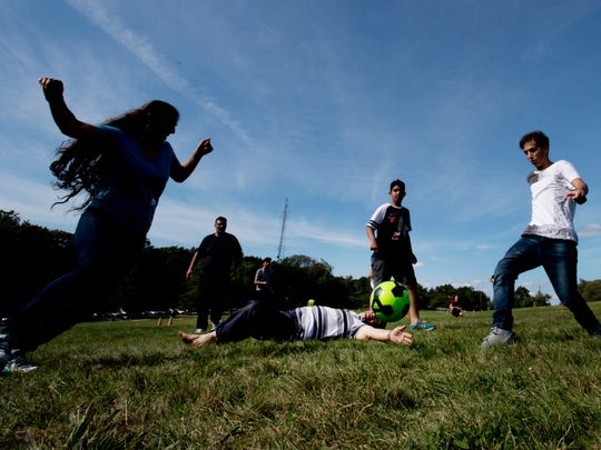 A soccer game during a picnic Sunday at Garret Mountain