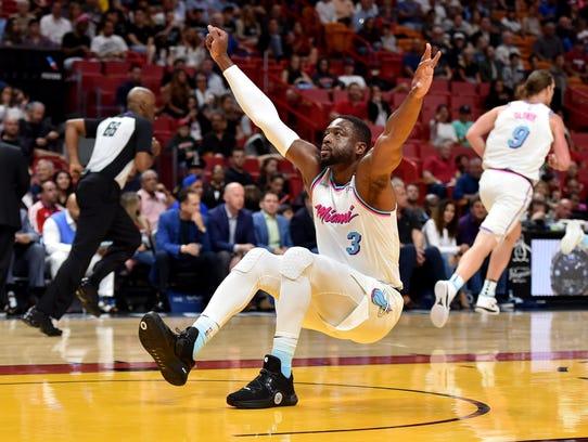 Miami Heat guard Dwyane Wade (3) lost his balance during
