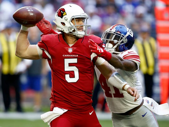 FILE - In this Dec. 24, 2017, file photo, Arizona Cardinals quarterback Drew Stanton (5) throws as New York Giants cornerback Dominique Rodgers-Cromartie (41) makes a hit during the first half of an NFL football game in Glendale, Ariz. The Giants cut veteran Rodgers-Cromartie on Sunday, March 11, 2018. Rodgers-Cromartie and the team failed to rework his contract, which called for him to make $6.5 million in salary and a cap hit of $8.5 million. (AP Photo/Ross D. Franklin, File)