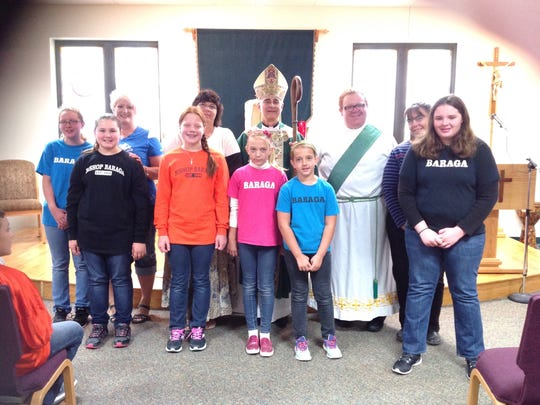 These are students from Bishop Baraga Elementary School in Cheboygan. They are travelling by bus to attend events in Philadephia to see Pope Francis. In the background is Diocese of Gaylord Bishop Steven Raica.