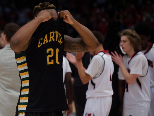Carver's Lyndell Wilson (20) reacts as Muscle Shoals