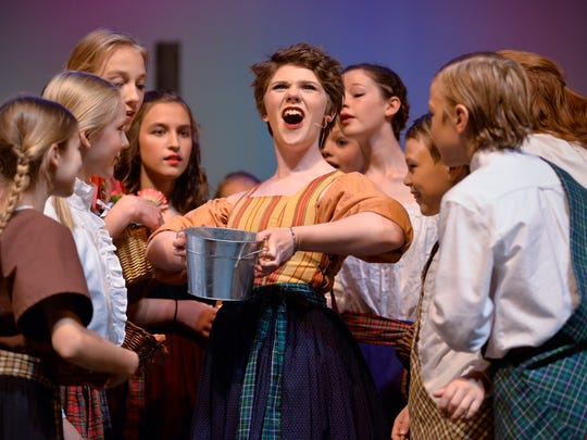 "Milkmaid Meg Brockie (Ahnika Lexvold) sings to the children of Brigadoon during a dress rehearsal of the Homeschool Theatre production of ""Brigadoon"" Wednesday, June 8, at Sartell High School"