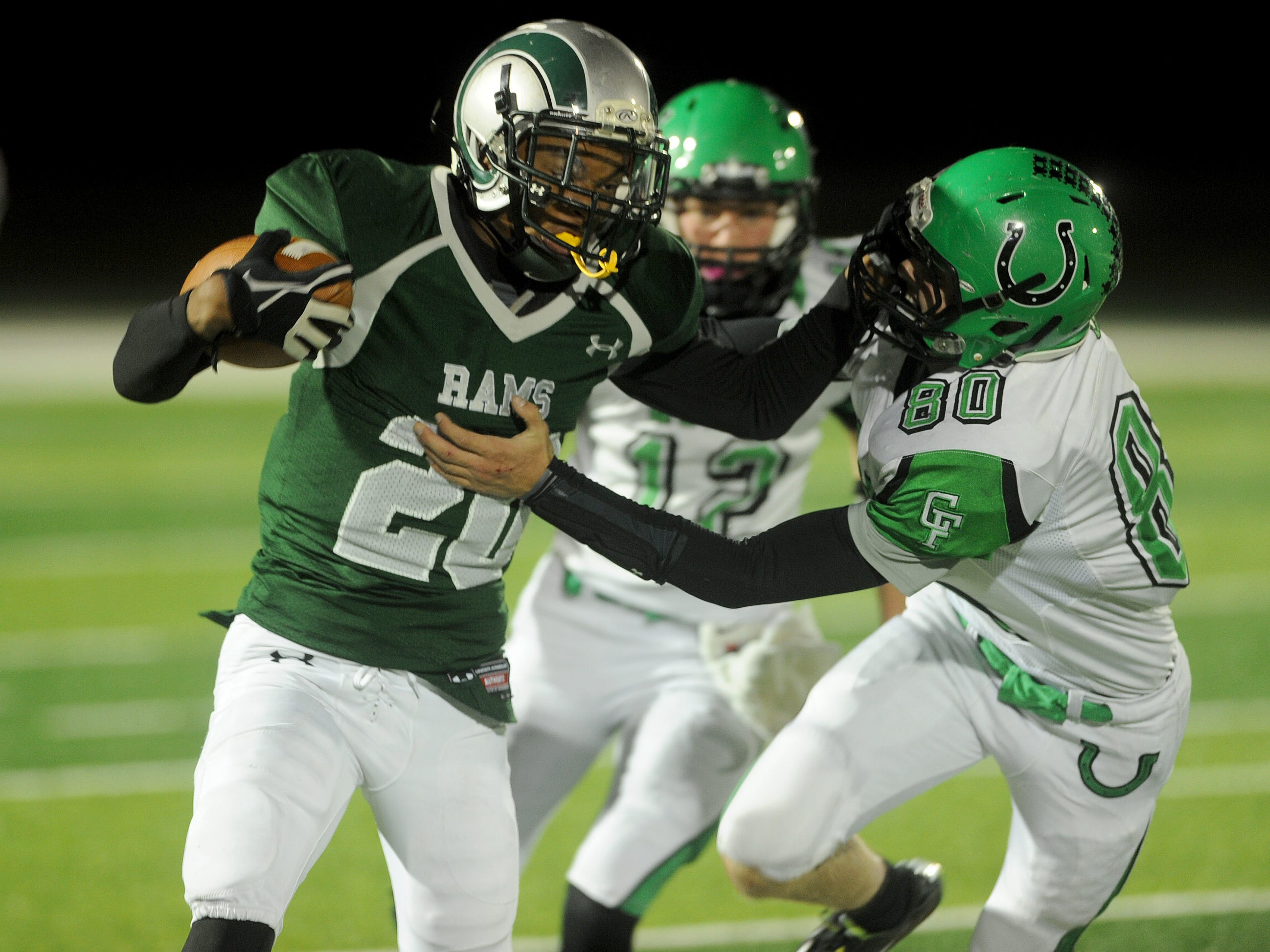 """Madison's Juwan Howard fights off the tackle of Clear Fork's Nate Hosey in a game last season. Howard is already an all-star """"vet,"""" having scored a touchdown in the big school state contest."""