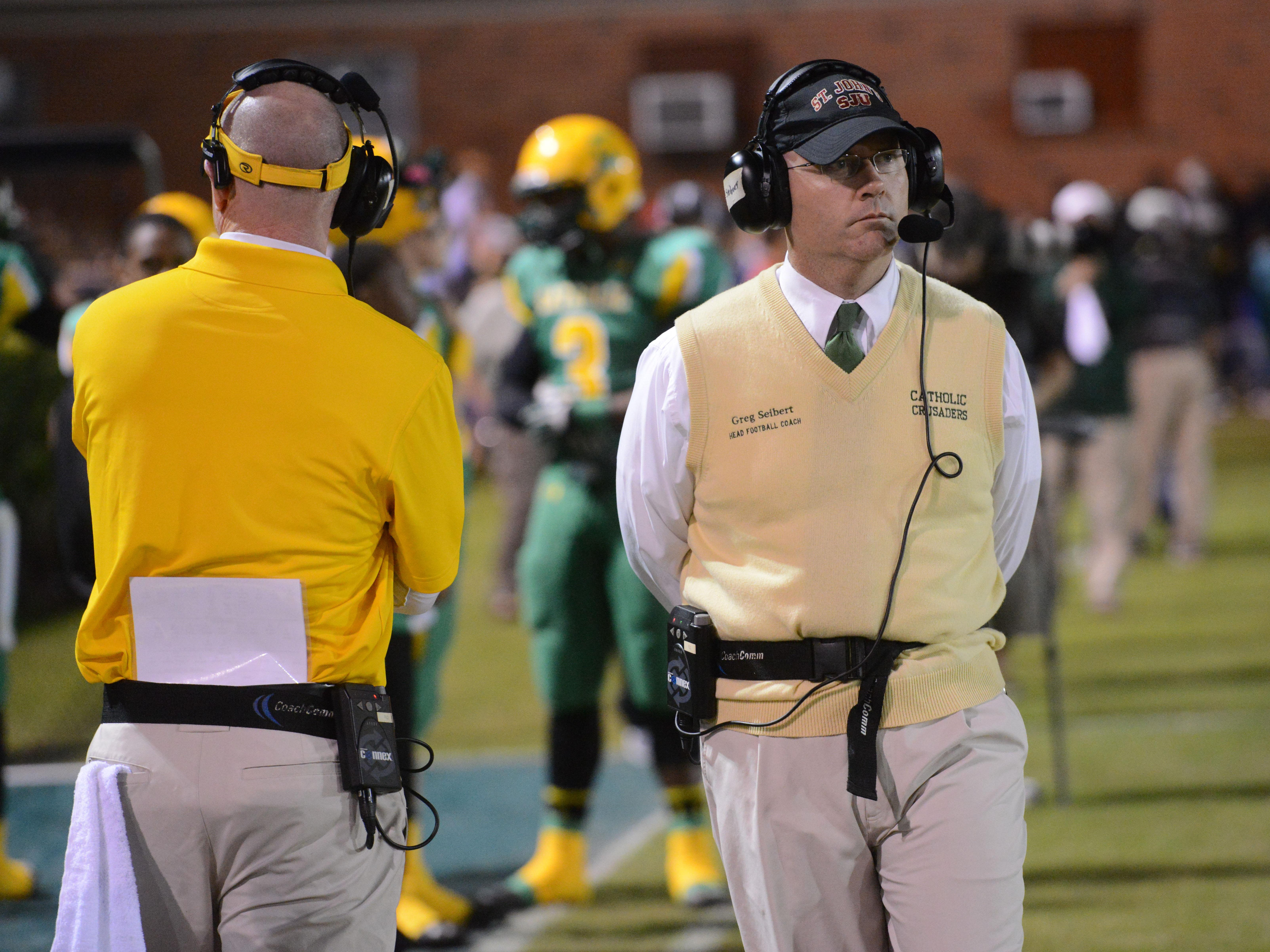 Catholic High coach Greg Seibert watches calmly from the sidelines Friday night during a Region 1-5A semifinal game against West Florida. Seibert is looking for some health and depth as the Crusaders try to build on last year's playoff team.