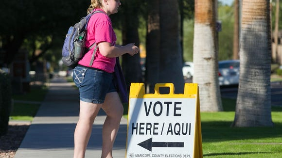 11/6/12 -- 06112012no Election Day -- Voter Robin Cronbaugh (Cq) leaves her polling place at Salvation Army Phoenix Citadel Corp after dropping off her mail-in ballot in Phoenix on Tuesday, November 6, 2012. Michael Schennum/The Arizona Republic