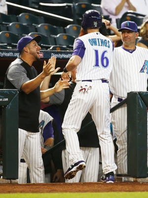 Arizona Diamondbacks Chris Owings is welcomed after scoring against the San Diego Padres in the 1st inning on Thursday, June 8, 2017 at Chase Field in Phoenix, Ariz.