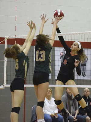 Catherine Brennan tips the ball for Union-Endicott on Wednesday during the Section 4 Class A volleyball championship match against Vestal at Chenango Valley.