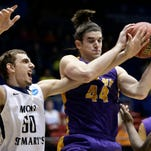 Albany's John Puk, right, pulls a rebound away from Mount St. Mary's Taylor Danaher in the first half of a first-round game of the NCAA tournament on Tuesday in Dayton, Ohio.