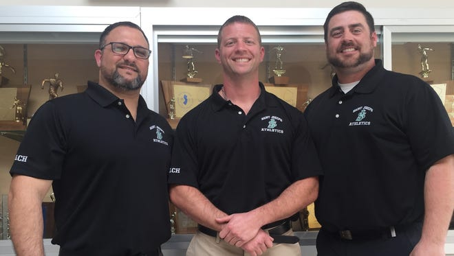 From left to right, St. Joseph assistant wrestling coach Joe Liquori, head coach Mike Carbone and St. Joseph athletic director Mike Murray.