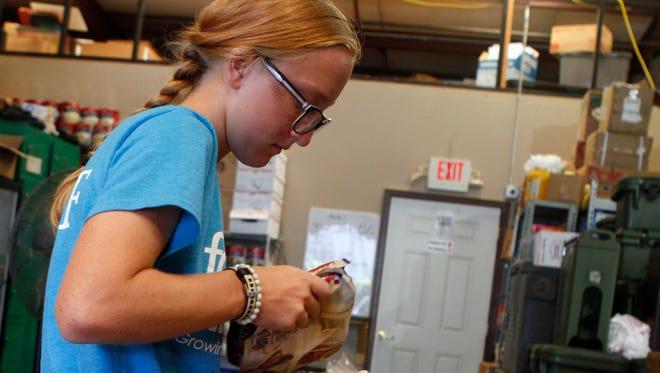 Tannar Dunnick is working with Food Initiative this summer, one of her responsibilities is helping out at Manna Cafe.