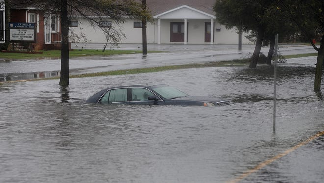 A car sits flooded near downtown Crisfield during Hurricane Sandy in 2012.