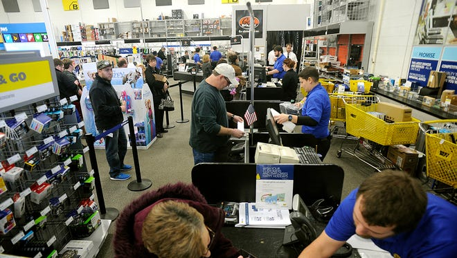 Best Buy employees in Wilkes-Barre Township, Pa., help customers with returns and exchanges Dec. 26, 2014. Many retailers have extended return policies for purchases made during the holiday season.