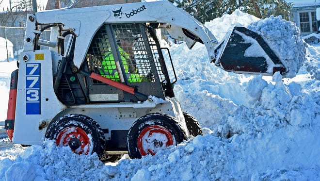 Borough worker Russell Lake uses a Bobcat to plow snow off West Nelson Street, Monday, Jan. 25, 2016 in Chambersburg.