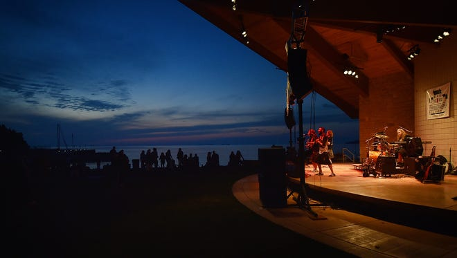 The Celtic rock band Whiskey Of The Damned from Milwaukee entertains on the Sister Bay Beach at Waterfront Park during the Midwest SunSplash Music Festival on Aug. 8, 2015. A noise complaint has been issued against the Wednesday music series that starts at 6 p.m. in the park this summer.