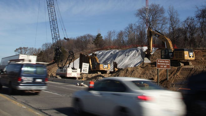 Vehicles pass a construction area on westbound Interstate 96 last month. Six bridges that carry I-96 over U.S. 23 and Old U.S. 23 will be replaced.