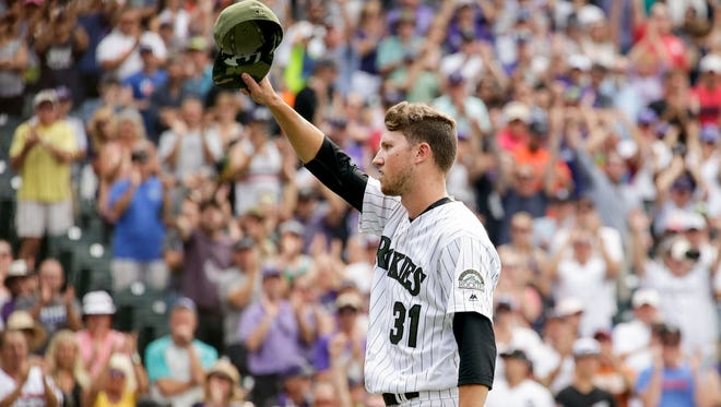 Colorado Rockies starting pitcher Kyle Freeland (31) gestures to the crowd in the ninth inning against the Chicago White Sox at Coors Field.